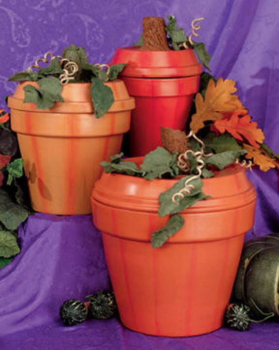Turn a terracotta pot into a decorative pumpkin by painting them orange. It's the perfect craft for transitioning from summer to fall!: