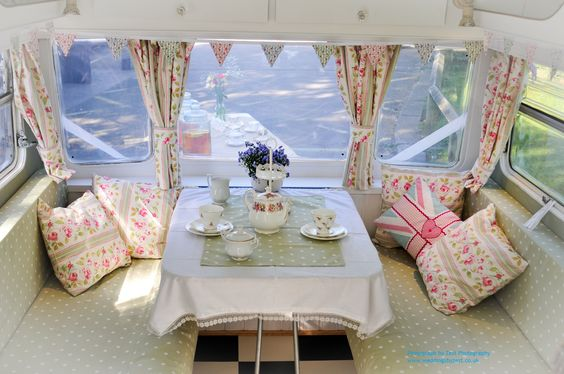 The interior of a gorgeous vintage caravan all ready for afternoon tea.  Available to Hire for weddings/parties and events