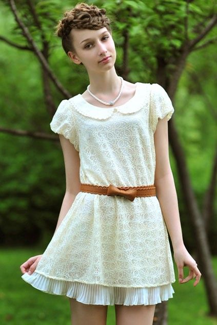 The Peter Pan collar makes a short white dress more demure.