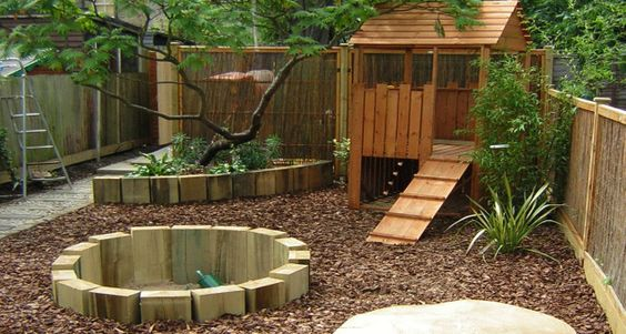 The play area has a sunken sand pit constructed with new sleepers, together with a play house and 'mushroom' table. The whole area is mulched with a thick layer of play bark to protect little hands and knees against falls.