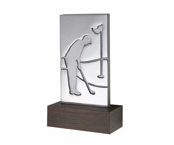 Peça: bidimensional com relevos, 16cm de altura.  Materiais disponíveis: alumínio (prata) ou bronze (dourado ou patinado).  Base: madeira natural ipê ou madeira revestida de fórmica preta, 12x6x2cm.  Placa cortesia: aço inox (prata) ou latão (dourada), 6x2cm.