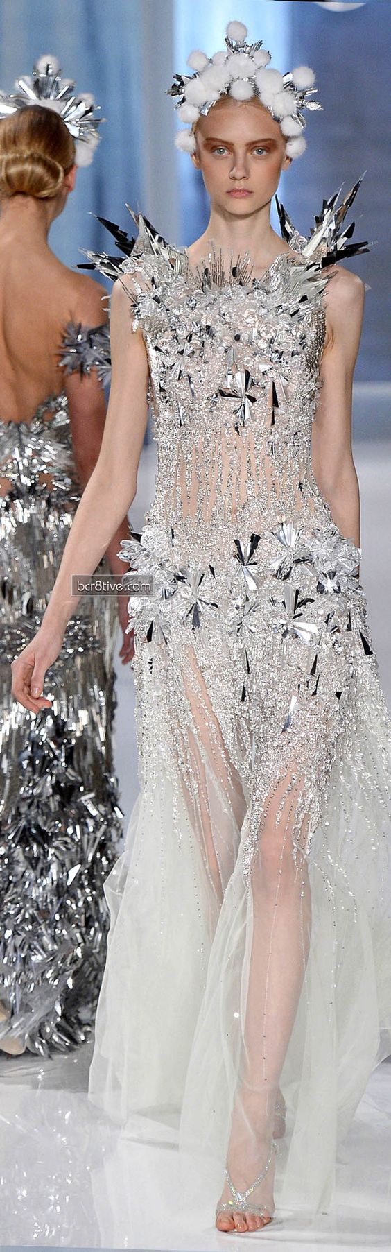 Valentin Yudashkin FW 2013-14....The sharp spiky crystal and bead that encrust this gown give it a texture that likes it ice and snow for a frozen ice princess look.