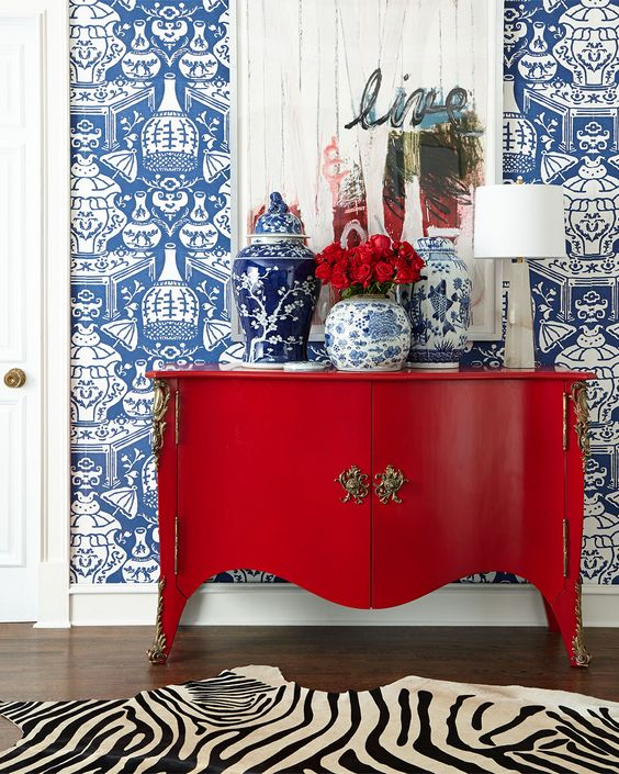 Palm Beach style, Jonathan Adler, Spring 2015, colourful living, interior design, red lacquer sideboard, blue wallpaper, vignette, luxury home decor, stylish interiors