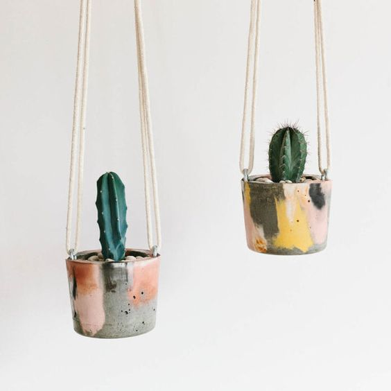 This handmade concrete hanging planter measures approximately 9cm high x 10cm diameter and comes with a 40cm rope. It is perfect for small