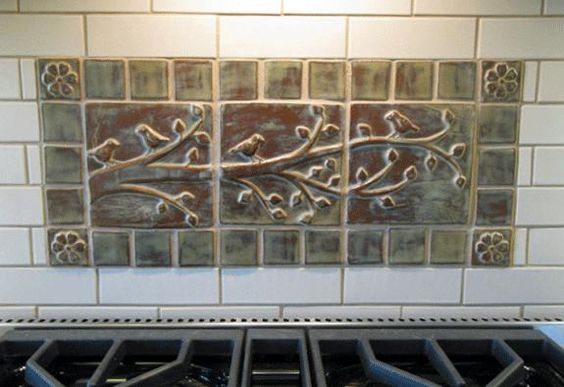 Art tile mural over stove in kitchen interior for Art deco tile mural