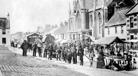 Old photograph image of the Saturday street market in Newburgh, Fife, Scotland