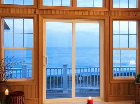 A Corner That Has Glass Sliding Doors That Lead To The Outside Patio Impact Windows Impact Windows Our Sliding Glass D Windows Hurricane Panels Impact Windows