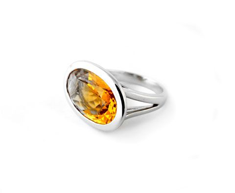 An 18ct white gold ring set with a large oval faceted citrine The