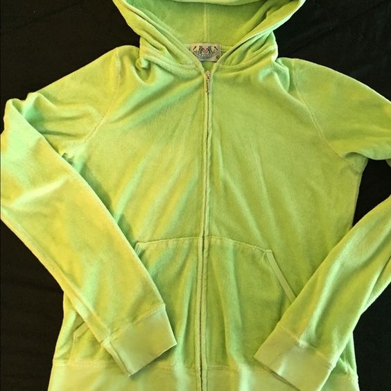 Juicy Couture sweat jacket Bright yellowish green Juicy Couture Terry cloth sweat jacket. In used condition and has a  hole by one of the pockets and a black mark on one of the sleeves. As shown I picture. Juicy Couture Jackets & Coats