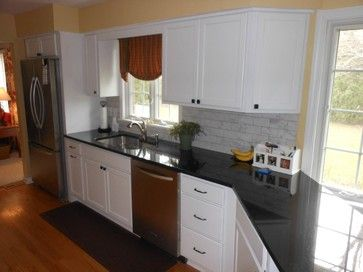 Simple but efficient, white shaker style kitchen designed by Eunice Siefert Evans, ASID.