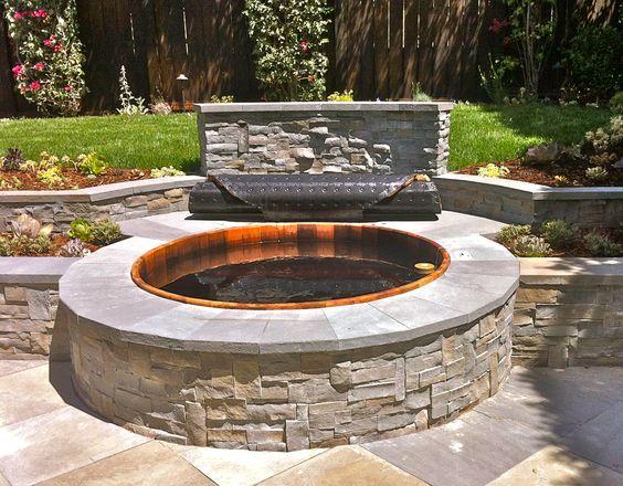 Beautiful cedar hot tub set in stone. www.gordonandgrant.com