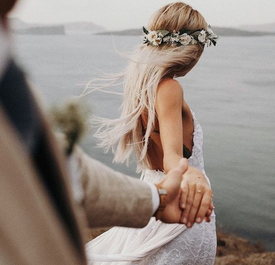 bohemian bride wearing flower crown and lace wedding dress with spaghetti straps