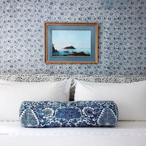 Blue and white traditional bedroom decor may make you a believer in wallpaper! Design by Markham Roberts. #bedroomdecor #blueandwhite #traditional #wallpaper