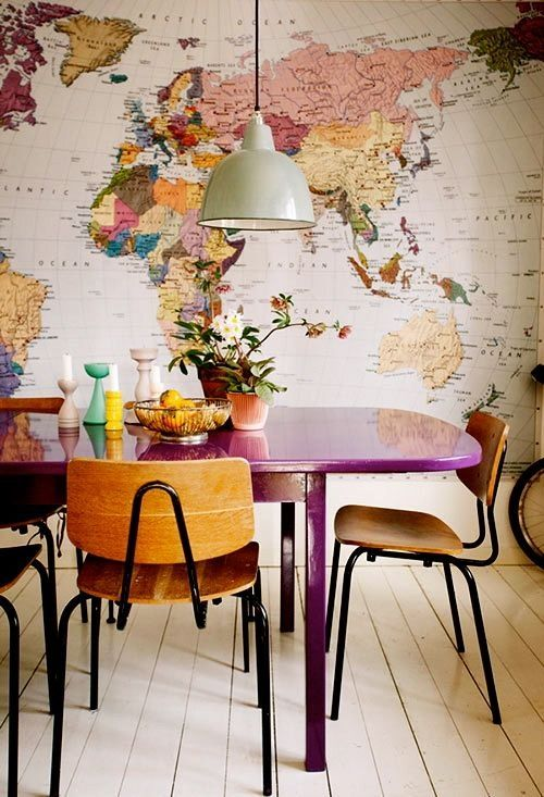 Colorful dining room. Purple table. Wood. Map.