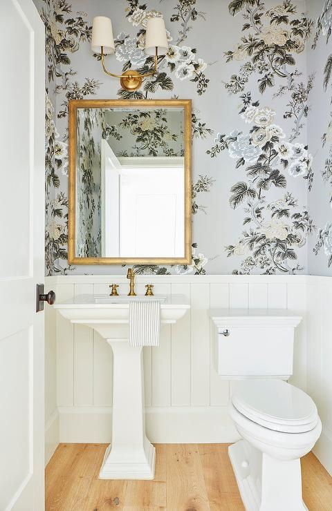 Welcoming Luxurious Powder Room Is Fitted With A Pedestal Sink