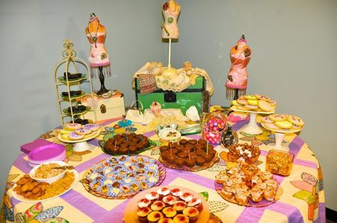 Vintage Theme for your Rehearsal or Wedding Dinner. Using quilts, vintage depression glass in pinks and greens, pie stands, and old doll trunks. Accent pieces include mini dress mannequins from Hobby Lobby, and antique jewelry brooches, pearls, and earrings.