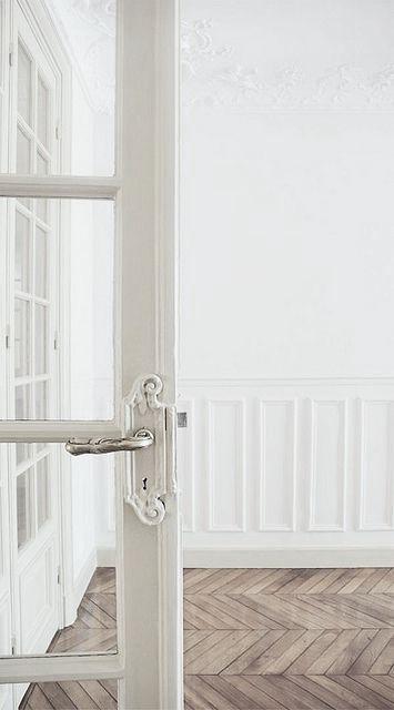 Interior Details: White Wall Panels, Ceiling Rose, Oak Herringbone/ Parquet Floors, French Doors, Ornate Silver Handles