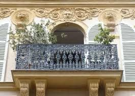 The balconies with cast iron rails