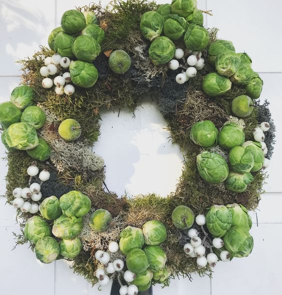 Why not go for the edible wreath this year? Brussels sprouts add veggie green interest to a mossy base.