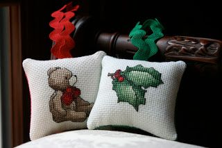 Cross stitch Christmas pillow ornaments.