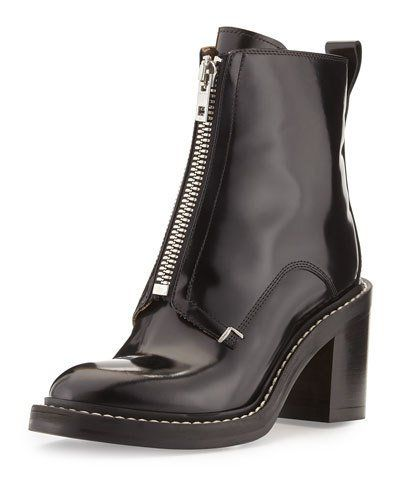 "Rag & Bone patent Italian calf leather bootie. 2.5"" stacked block heel. Round toe. Front zip closure. Leather outsole. ""Shelby"" is made in Italy."