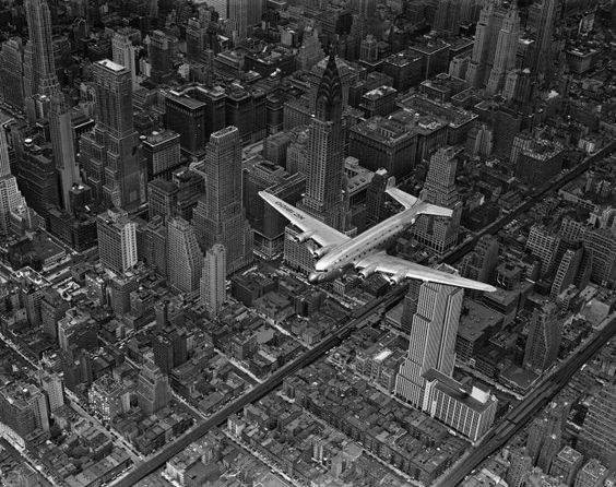 1939 | Aerial view of a DC-4 passenger plane flying over midtown Manhattan. An almost identical photograph from this shoot was published in the June 19, 1939, issue of LIFE.