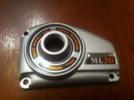 one new shimano ml-20 ,side plate, part # 42, vintage new old, Fishing Reels