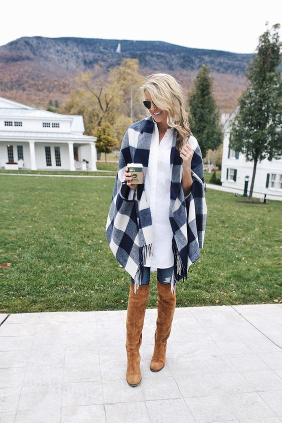 A bold look, lots of garments layered, knee high boots with skinny jeans looks surprisingly good but only with the oversized top. Otherwise it's a no-no.:
