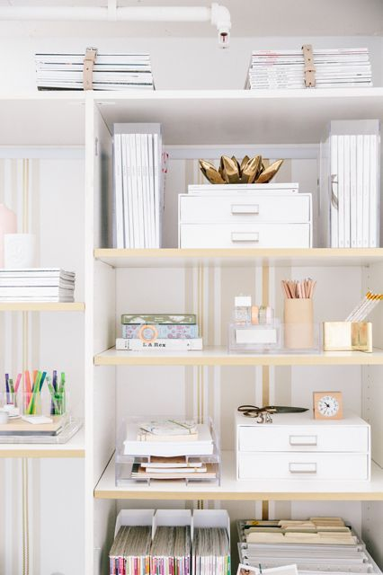 """Who says your office supplies have to be hidden away?! By sticking with a monochromatic color palette, we turned them all into part of the office decor."":"