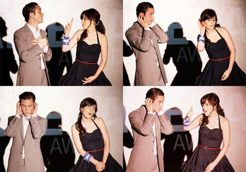 Joseph Gordon-Levitt and Zooey Deschanel doing their thang. Looking cute.