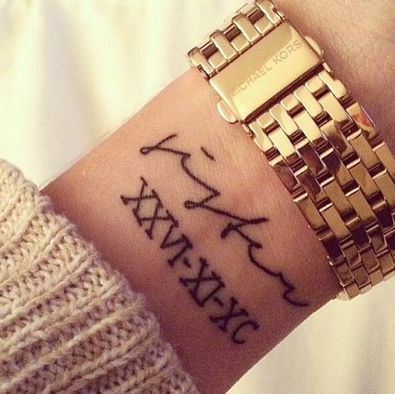 I would like my parent's birth dates on my wrist with family written above, or my anniversary in Roman numerals.