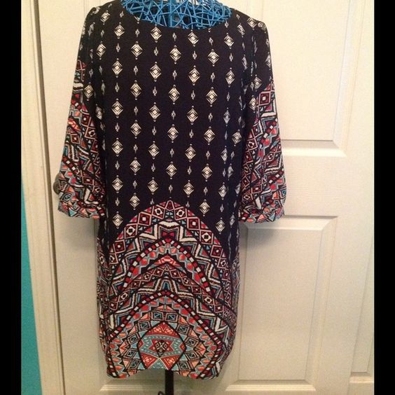 Tribal Print Dress - NWOT This tribal print 3/4 length sleeve dress is an unexpected treat. Fully lined. Bring this beautiful dress on your next vacation. For day pair with simple flats. At night pair with some wedges and some statement bracelets. 100% polyester Pink Owl Dresses