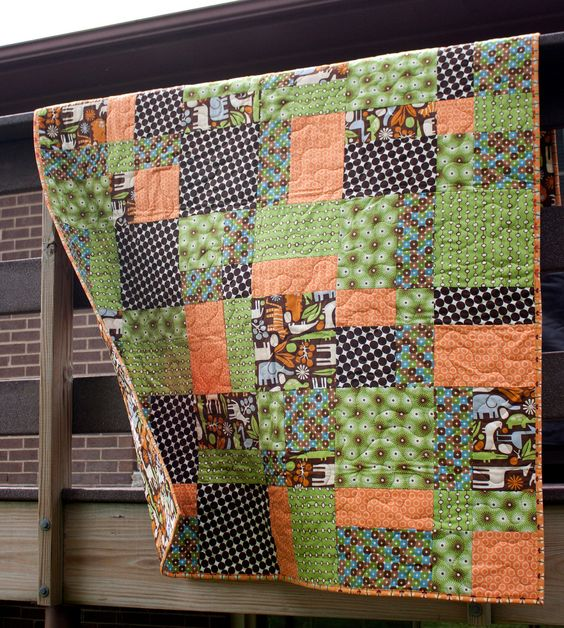 "baby boy quilt in green orange and brown // black friday etsy // zoo animal baby toddler bed or throw quilt. Finishes approximately 48"" x 64""."