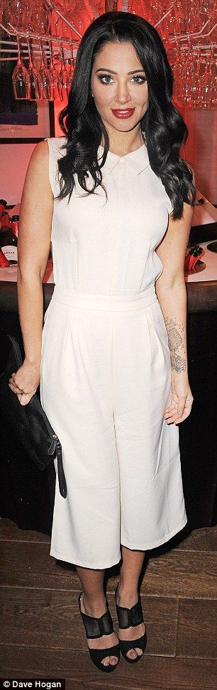 Back in the spotlight: Tulisa Contostavlos made her first public appearance since being ar...