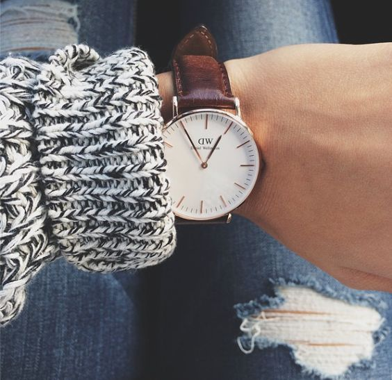 adding sleek oversized round watch to high contrast chunky sweater and ripped jeans.  totally paradoxical.