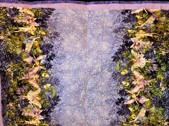 Baby quilt- Fairies in the Garden with backing of stars by GardenofQuiltsShop on Etsy https://www.etsy.com/listing/461993292/baby-quilt-fairies-in-the-garden-with