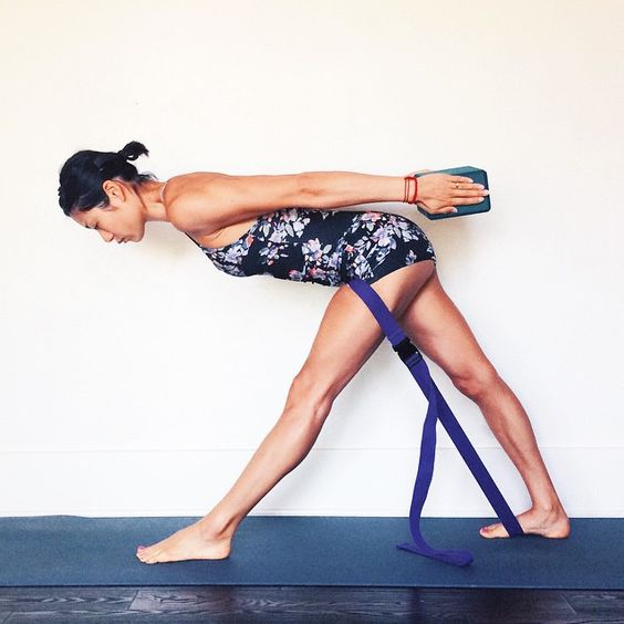 Parsvottanasana is a difficult pose in its own right, and can become a serious balancing pose when the hands are off the floor and behind the back in paschima namaskarasana (reverse prayer). For this variation, belt the front thigh against the back foot to press the femur bone back and lengthen the side waist. Step strongly on the belt with the back foot to feel the downward calf-heel connection to the forward chest and... http://instagram.com/p/3T7PWBAOPQ/