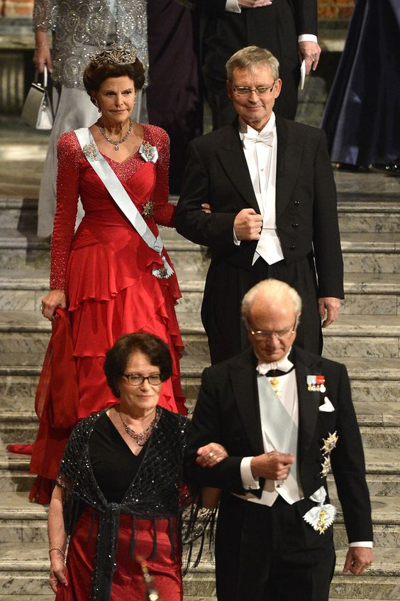 (2nd row L) Queen Silvia of Sweden and Chairman of the Board of the Nobel Foundation, Professor Carl-Henrik Heldin, and (1st row R) King Carl Gustaf XIV of Sweden and his dinner companion attend the Nobel Prize Banquet after the 2013 Nobel Prize Awards Ceremony at City Hall on December 10, 2013 in Stockholm, Sweden.
