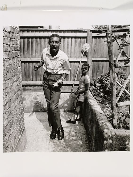 Neil Kenlock, 'Untitled [Young teenage boy who, just arrived from  Jamaica, shows off his latest reggae dance with his younger brother watching, Brixton Hill]', 1968. © Neil Kenlock
