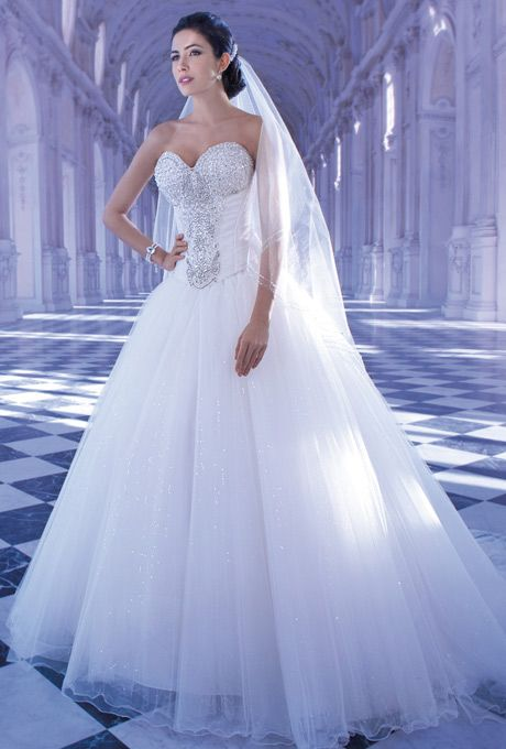 Brides: Demetrios - Young Sophisticates. Tulle ball gown with a sweetheart neckline, corset bodice with lace-up back and Basque waist. Bodice is embellished with shimmering beaded motif. Skirt features a chapel length train.
