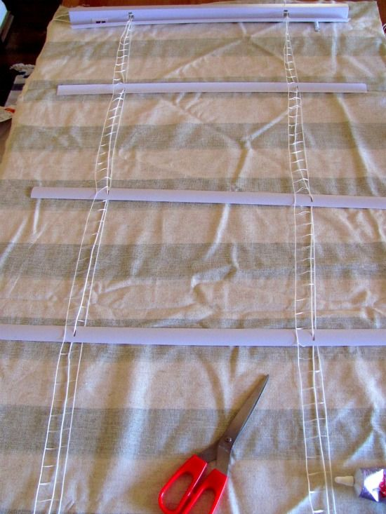 DIY Roman shades! so simple! and i think you could sew fabric on the back side so the blind isnt visible