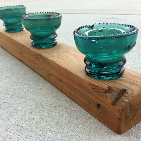 Center piece- made from reclaimed wood and electric line insulators add your favorite candle built by Rustic By Design in Charleston, SC