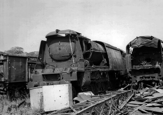 Work has started in Hayes, Bridgend scrapyard, on the destruction of the Southern Railway's finest. The two Bulleid 'Light Pacific's' having the torch taken to them in July 1966 are 'BB' 4-6-2 no.34075 '264 Squadron' and re-built 'BB' no.34062 '17 Squadron'. 34075 was withdrawn after just under 16 years and 34062 a year longer at 17 years and 3 months. In the late'60's we went round as many scrapyards as sheds, chasing steam locomotives.