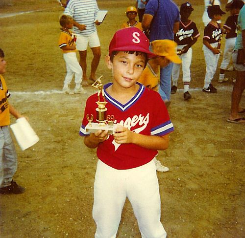 Matt holds trophy for team winning Guantanamo Bay, Cuba Little League Championship. Age 8 - 1988.