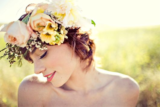 A floral headpiece replaces the traditional veil.  Ridiculously pretty.