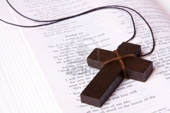 3679630-a-wooden-cross-lying-inside-a-bible-at-psalm-23-can-be-used-for-any-religious-concept.jpg (1200×801)