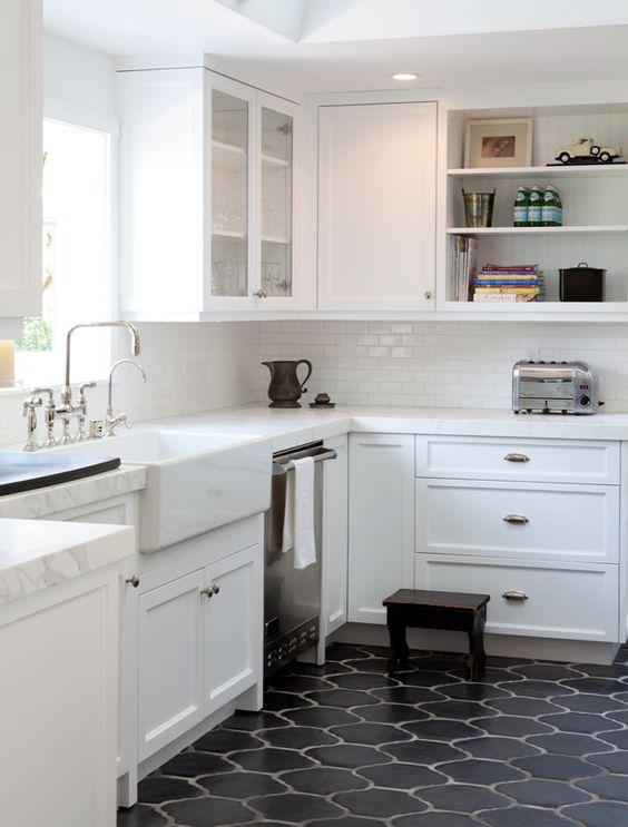 Amanda Masters - a Hollywood Hills bungalow kitchen with a great apron-front sink, tiles, glass-front cabinets, marble counters - desiretoinspire.net