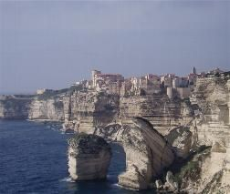 A view of the amazing town of Bonifacio which sits on the cliff edge. The rock in the foreground is called the Grain de Sable.