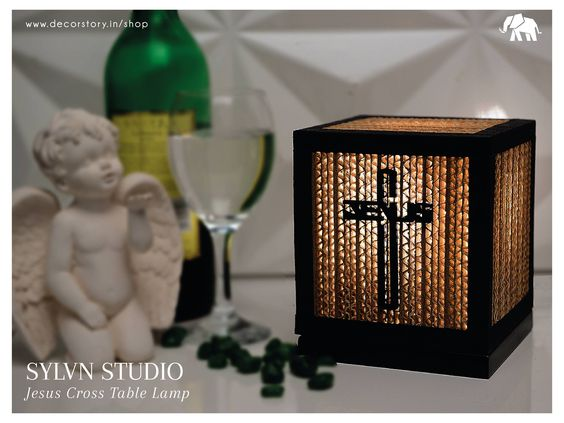 Dim light & a glass of #Wine is a perfect combination after a long day at #work!  Purchase our Jesus Cross Table Tamp designed by Sylvn Studio on www.decorstory.in.   #DecorStory #HomeDecor #TableLamps #JesusChrist #Serene #Calm #Peaceful #InteriorDesign #Decoration #HouseEssentials #DimLights