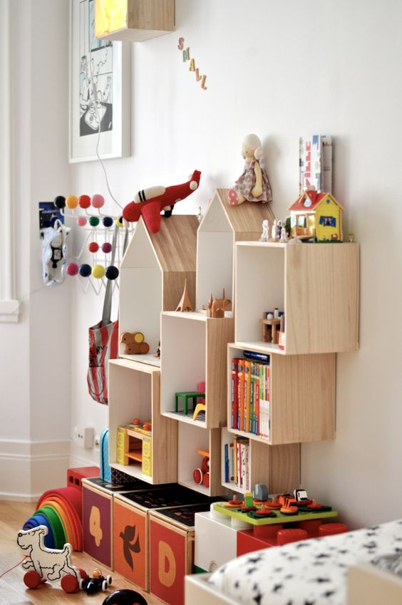 Really like the idea of mounting boxes in different sizes and shapes to display toys and books. Feels like a modern day take on a doll house.: